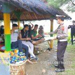 Cegah Penyebaran Covid-19, Ditlantas Polda Aceh Bagi Masker di Tempat Wisata